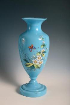 A painted vase of turquiose glass
