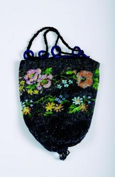A beaded bag decorated with flowers