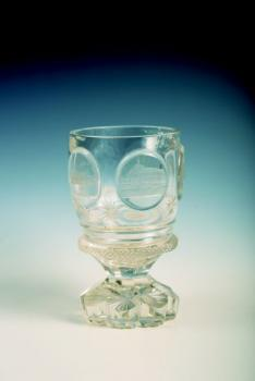 A crystal glass with engravings of German towns