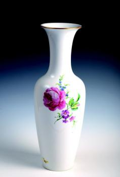 A porcelain vase with a painting of flowers