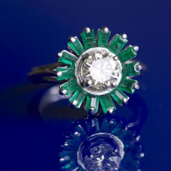 Platinum ring with diamond and emeralds
