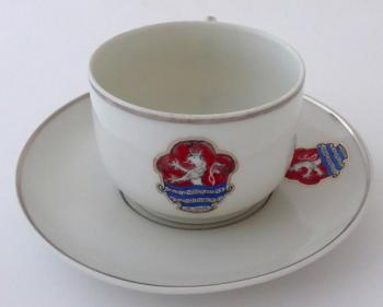 Cup with a saucer and the emblem of the city