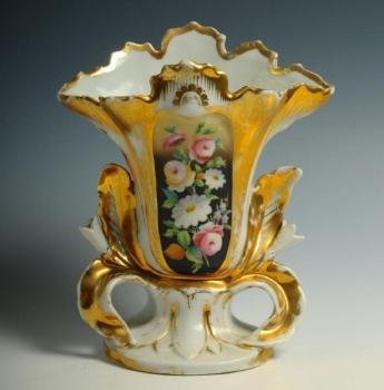 A small porcelain plastic decorated vase