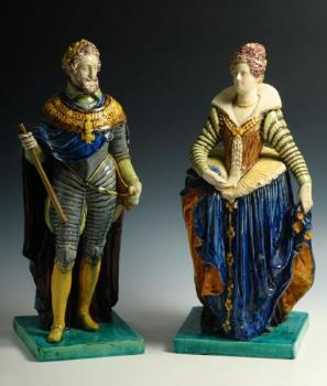 A pair of statues of imperator and a lady
